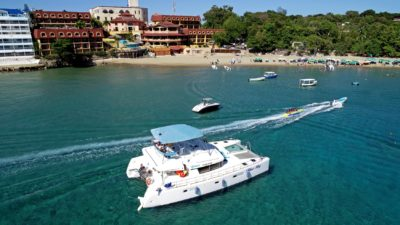 Catamaran rental docked in Sosua Bay