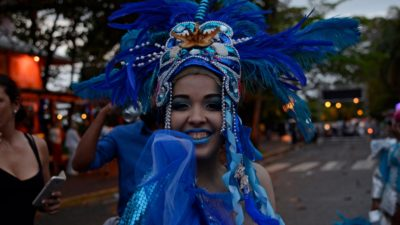 woman with feathered hat at carnival