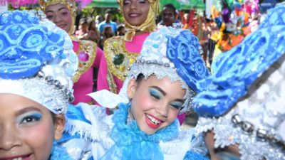 Girl smiles while participating in the Puerto Plata 2019 Carnival parade