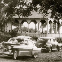Hotel parking area with vintage cars