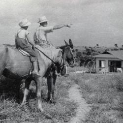 Settlers riding horses